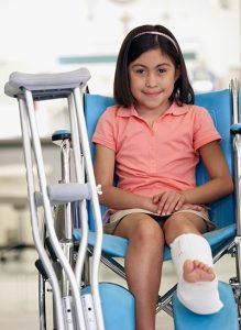 A child in a wheelchair with broken leg