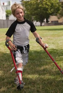 Boy with Muscular Dystrophy walking on crutches