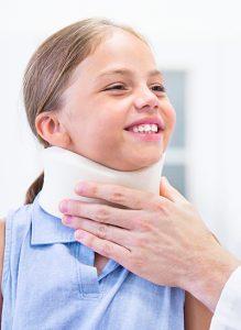 Little girl in a neck brace